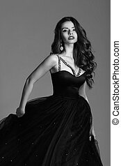 Pretty girl in ball gown - Young beautiful woman standing...