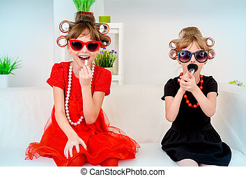 two little daughters - Two funny little girls with curlers...