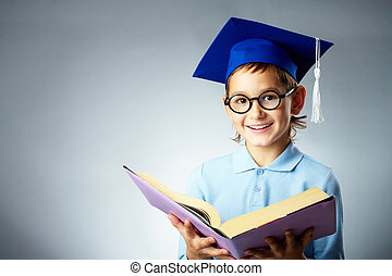 Happy reader - Portrait of cute lad in eyeglasses and...