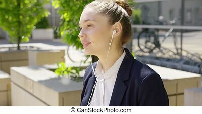 Lovely young girl with headphones - Young girl in formal...