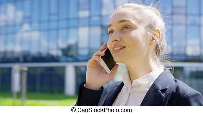 Young student talking phone on street - Young attractive...