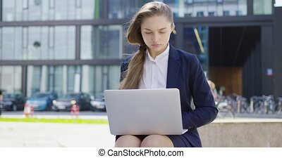 Concentrated woman in formal with laptop - Young...