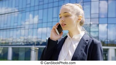 Young lovely girl in formal talking phone - Confident young...