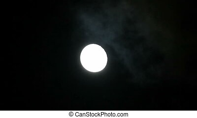 Full moon behind clouds. Audio track with cicadas.