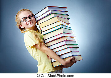 I love reading - Image of happy schoolgirl with stack of...