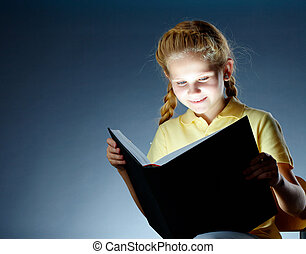 Child reading - Image of happy schoolgirl reading...