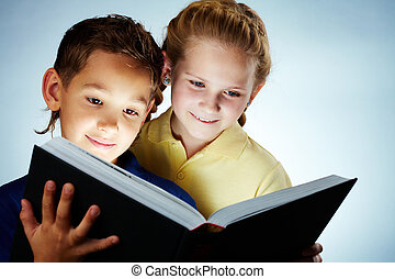 Reading together - Image of smart children reading...