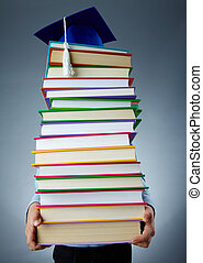 Holding books - Image of stack of books held by child