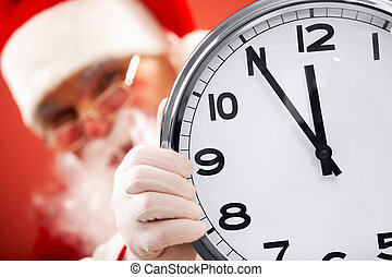 Five minutes to Christmas - Photo of clock showing five...