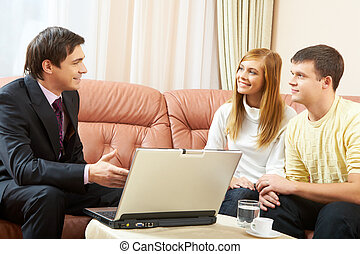 Realtor at work - Portrait of a businessman interacting with...