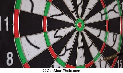 six Dart Arrows Hitting In Dartboard.