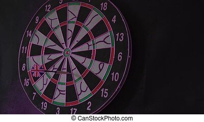 six Dart Arrows Hitting In Dartboard hit the bull's-eye.