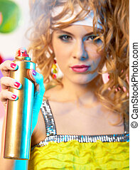 Spraying hair lacquer - Photo of hair lacquer in hand of...