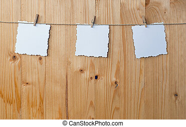 Three jagged note on wood, isolated on white