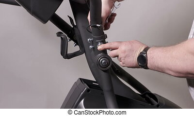 Elliptical trainer assembly process at home. Installing arm...