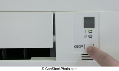 Wall mounted split air conditioner turning on. Closeup of...