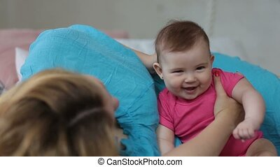 Loving mother stroking adorable baby girl head - Pretty...