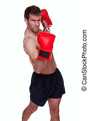 Male boxer isolated - Male boxer delivering a knockout punch...