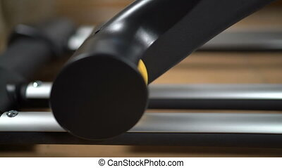 Elliptical machine rail with sliding wheels closeup during...