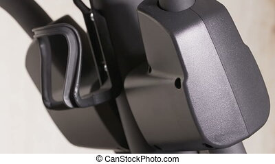 Elliptical trainer details in motion during workout closeup...