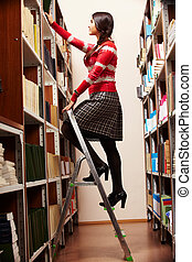 Steps to knowledge - Portrait of college student choosing...