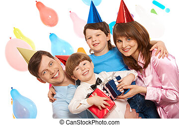 Birthday fun - Portrait of happy boys and their parents...