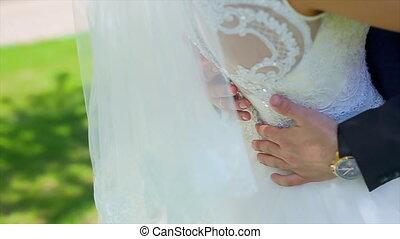 Grooms Hands on Waist of Bride.