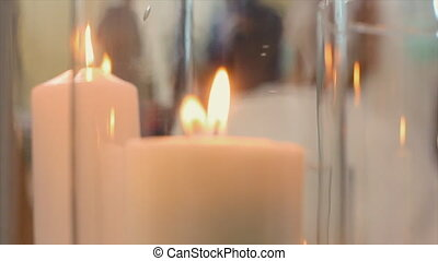 Glass Jars with Candles Inside - View of glass jars with lit...