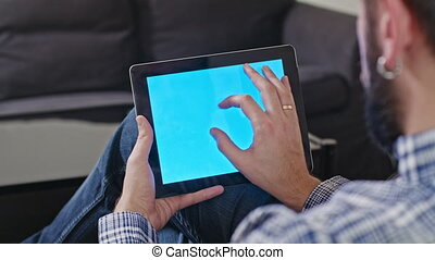 Man with a Digital Tablet with Blue Screen