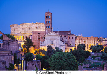 Forum Romanum and Colosseum in Rome after sunset, Italy