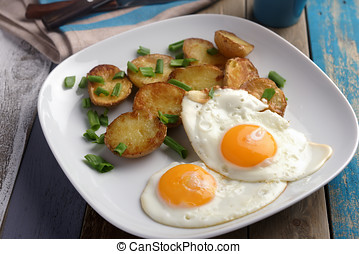 Fried eggs with potato - Fried eggs with roasted potato and...