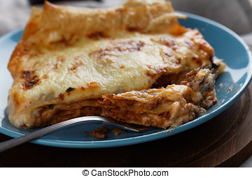 Lasagna Bolognese on a rustic table