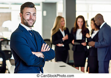 Businessman leader in modern office with businesspeople working at background