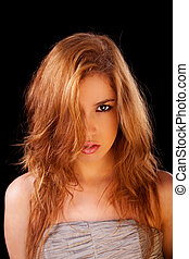 Pretty young caucasian girl, with golden reflexion, isolated on black, studio shot