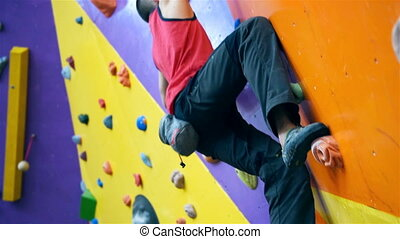 ? - Climber Man On Artificial Climbing Wall In Bouldering...