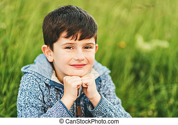 Close up portrait of adorable 6 year old boy