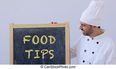 Chef with FOOD TIPS sign - FOOD TIPS text with chef in...
