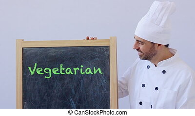 Chef with vegetarian sign - vegetarian text with chef in...