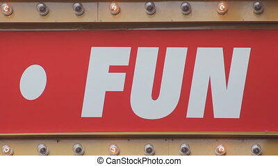 FUN sign. - Sign that says %u201CFUN%u201D with flashing...