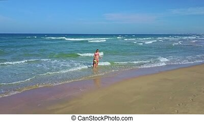 Drone Shows Mommy and Daughter Playing in Ocean Waves