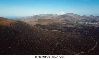 Flying over wine valley of La Geria, Lanzarote, Canary...