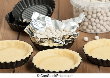 Cooking Process Of Tartlets. Ceramic Baking Beans. Tins. -...