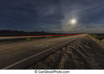 Route 66 with Full Moon and Streaking Train - Route 66 sign...