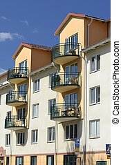 Apartment building facade with windows and balconys at...