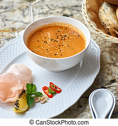 Peranakan cuisine. Singapore Laksa soup served with glass of...