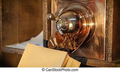 Man fills up coffee beans in the package