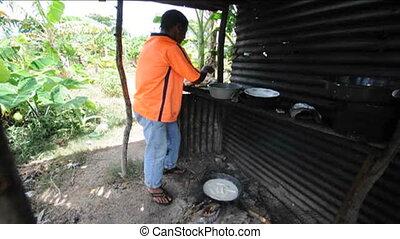 Nicaragua man cooking outdoors - native Nicaraguan man...