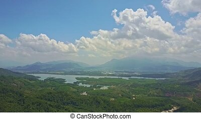 Flycam Shows Panoramic View Jungle River against Mountains
