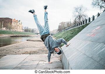 Hip hop performer, upside down motion on street - Hip hop...