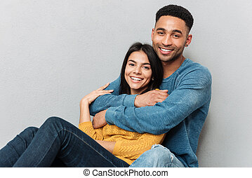 Lovers hugging and looking camera - Pretty lovers hugging...